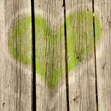 Green heart on old wood Royalty Free Stock Images