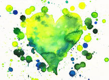 Green heart with paint splashes Stock Photography
