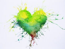 Green heart with paint splashes watercolor painting Stock Photo