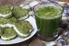 Green heart shaped cookies and a cocktail of fresh spinach Royalty Free Stock Photo