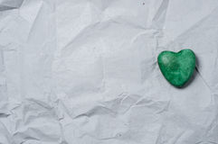 Green heart of stone. Of a recycled paper Royalty Free Stock Photography