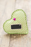 Green heart with tag Royalty Free Stock Images