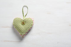 Green heart on a white background Stock Photo