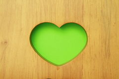 Green heart in wood Stock Photo
