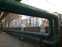 Green heating pipeline. In city community Stock Photography