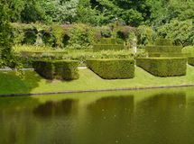 Green hedges plants and trees. The romantic garden of the  borg Verhildersum a castle in Leens in Groningen in the Netherlands Stock Photos