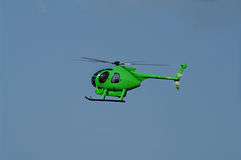 Green Helicopter in flight Royalty Free Stock Photo