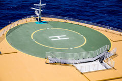 Green Helicopter Pad on Deck of Ship Stock Photo
