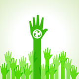 Green helping hand background with recycle icon Royalty Free Stock Photo