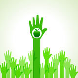 Green helping hand with green apple Stock Image