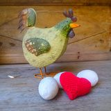 Green hen and red love heart in  white egg pile Stock Photography