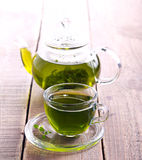 Green herb tea in glass cup Royalty Free Stock Photography