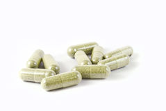 Green herbal medicine capsule isolated Royalty Free Stock Photography