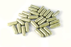 Green herbal medicine capsule isolated Stock Photo