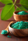 Green herbal salt for healthy spa bath Royalty Free Stock Images