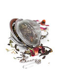 Green herbal tea with dried flowers in tea strainer Royalty Free Stock Photo