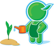 Green hero Watering a Plant Royalty Free Stock Image