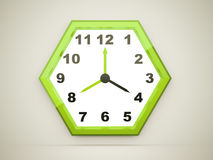 Green hexagonal clock rendered on dark Stock Photos