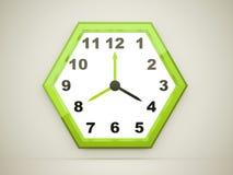 Green hexagonal clock rendered on dark Stock Photos