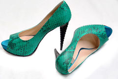 Green high-heeled shoes and a platform Stock Photo