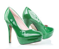 Green High Heels shoes with platform. Fashionable platform High Heels in shiny green patent leather, isolated on white Royalty Free Stock Images