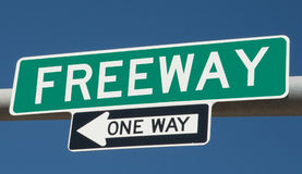 Green highway sign FREEWAY ONE WAY. A rendering of a highway sign FREEWAY ONE WAY royalty free illustration