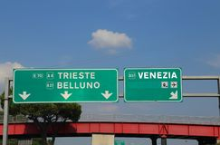 Green highway sign in Italy indicating the road to the cities. Green highway sign in Italy indicating the road to Venice Belluno and Trieste stock photos