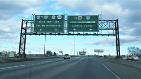 Green highway signs for Manhattan bridge and tunnel royalty free stock photos