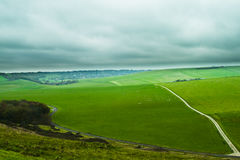 Green hill. With a road royalty free stock photography