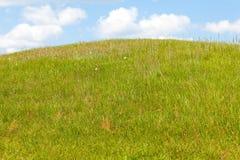 Green Hill below Blue Sky Stock Image
