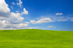 Green hill on blue sky Royalty Free Stock Photo