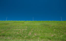 Green hill and blue sky Royalty Free Stock Images