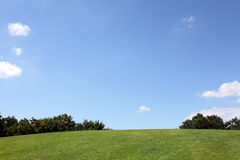 Green hill with blue sky and cloud Royalty Free Stock Photography