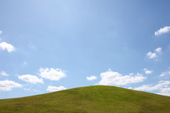 Green hill with blue sky and cloud Royalty Free Stock Images