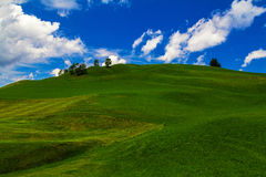 Green hill and blue sky in landscape Royalty Free Stock Photos