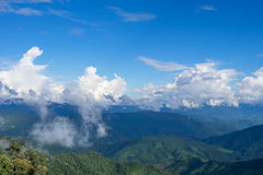 Green hill and blue sky view. Green hill and blue sky scene view in Nan province, Thailand Royalty Free Stock Image