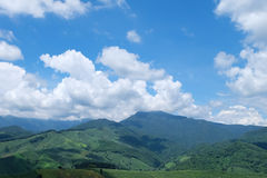 Green hill and blue sky view. Green hill and blue sky scene view in Nan province, Thailand Stock Photo