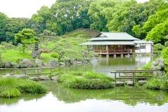 Green hill, bridge, pavilion building in zen garden Royalty Free Stock Photos