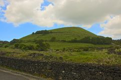 A green hill in the farmlands of the Azores Stock Photo