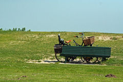 Green hill near the coast with bench and bike Stock Photography