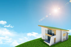 On green hill stands cottage with brickwork Royalty Free Stock Image