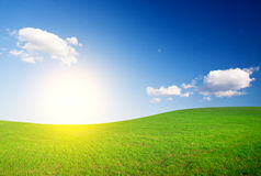 Green Hill Under Blue Cloudy Sky Whit Sun Stock Photos