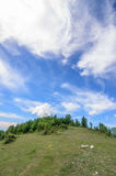 Green hill under blue sky with white clouds. Beautiful summer landscape. Nature of Georgia Stock Photography