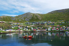 Green Hill With Fishing Town On The Side Of Fjord Royalty Free Stock Images
