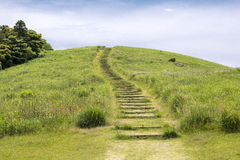 Green hill with wood stairs. Under sky in Hirado, Nagasaki Stock Image