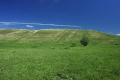 Green Hills. And blue sky in the early summer Stock Images