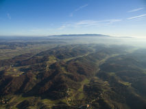 Green hills. Aerial view over green hills Royalty Free Stock Photo