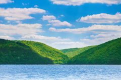 Green hills on bank of river Royalty Free Stock Photos