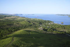 Green hills and the blue sea. Russia, Slavianskii gulf with coast in the summer Stock Images