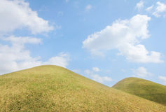 Green hills with blue skies Royalty Free Stock Photo